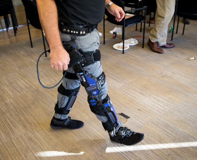 Keith Maxwell, Senior Product Manager of Exoskeleton Technologies at Lockheed Martin, demonstrates an Exoskeleton. Photo: Reuters