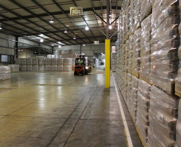Milk powder prices rose just 0.1% at the latest global dairy trade auction; pictured, milk powder warehoused at Fonterra's Edendale processing site in Southland. Photo: ODT files