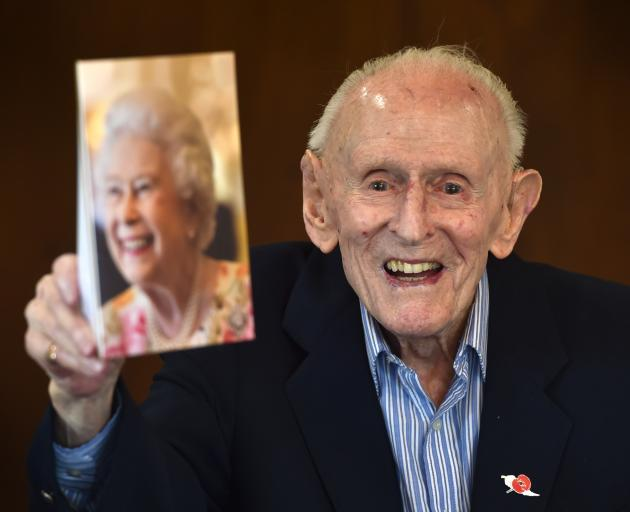 Mosgiel resident Gerald Huntley with a birthday card from the Queen. PHOTO: PETER MCINTOSH