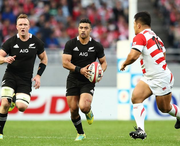 All Black first five-eighth Richie Mo'unga looks to make a break backed up by replacement  loose...