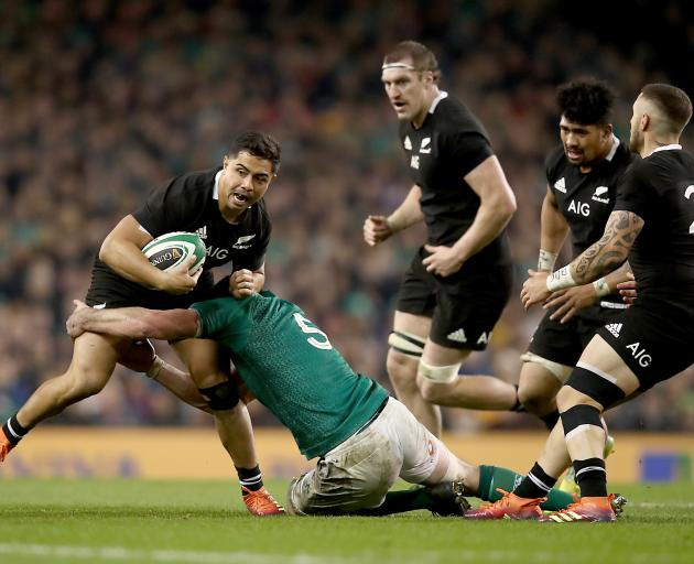 Anton Lienert-Brown, of the All Blacks, is tackled during the match against Ireland yesterday in...