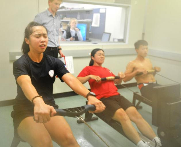 Taiwan rowers (from left) Chen Chao-Chen, Wang Yu-Wen and Chiang Shen-Hoa row in the School of...