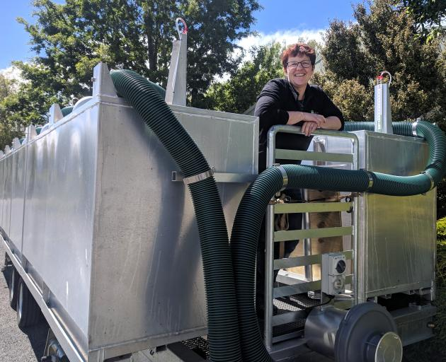 AgResearch scientist Dr Suzanne Rowe with a trailer being used to measure methane emissions in...