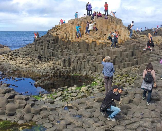 Part of the Giant's Causeway near where the basalt columns meet the sea.