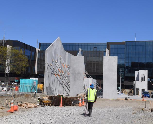 A pre-cast concrete panel goes up in front of Christchurch's justice precinct, one of 16 jobs which tipped Fletcher into reporting massive losses. Photo: Stephen Jaquiery