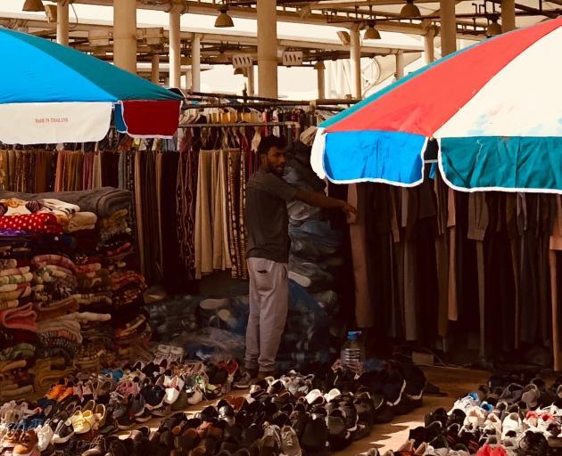 A shoe seller at a souk in Riyadh. Photo: Supplied