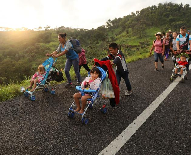Members of the Central American migrant caravan move to the next town in Matias Romero, Mexico. Photo: Getty Images