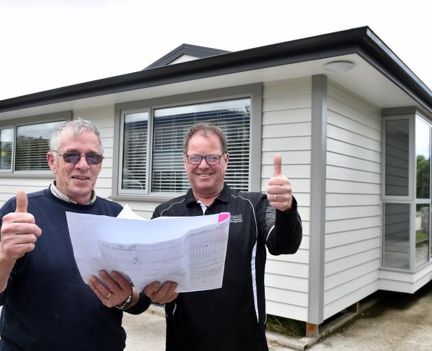 Otago Polytechnic carpentry programme manager Graham Burgess (left) and Kevin Dunbar with senior lecturer Kevin Dunbar in front of their 2018 auction house. Photo: Peter McIntosh