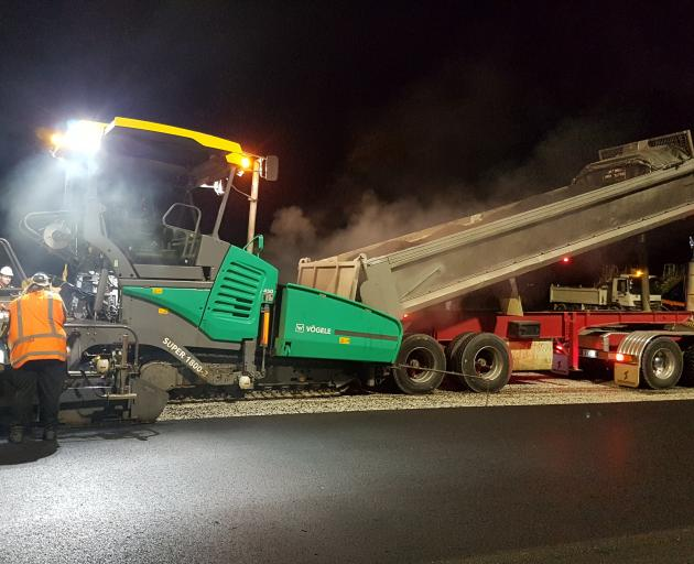 A Downer crew works on resurfacing Queenstown Airport's apron using TonerPave. PHOTO: SUPPLIED