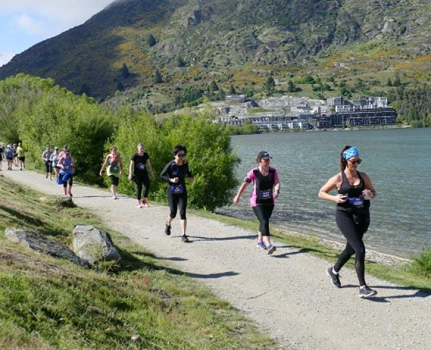 Runners make their way past Frankton Beach during today's Queenstown International Marathon. Photo: Joshua Walton