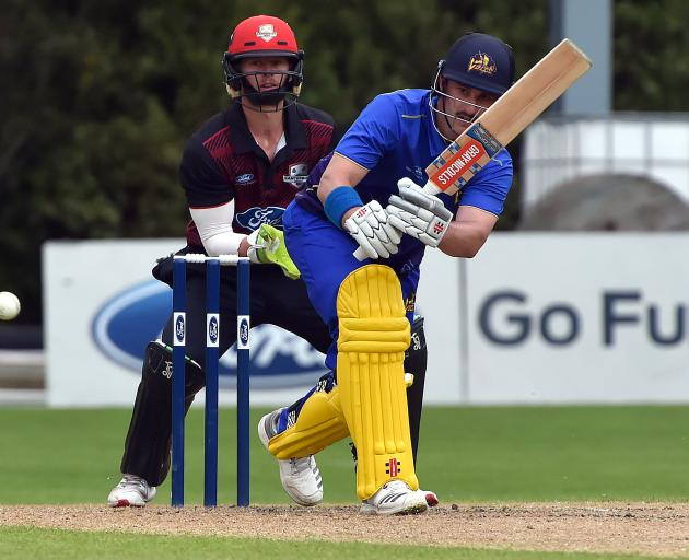 Otago batsman Hamish Rutherford plays the ball to the onside during his magnificent innings of 154 in a one-day match against Canterbury at the University of Otago Oval yesterday. The Canterbury wicketkeeper is Cam Fletcher. Photo: Gregor Richardson