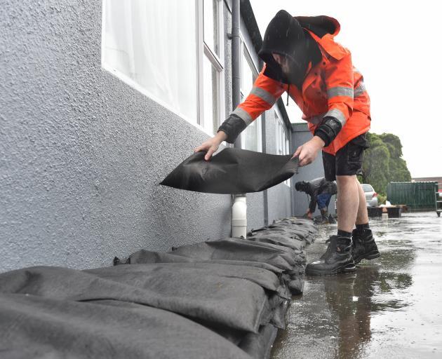 Todd McIvor, of McIvor Plumbing, places sandbags around the Radius Fulton aged-care facility in...
