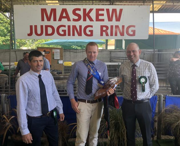 Thrilled with his junior sheep judging win at the New Zealand Agricultural Show last week, is Will Stuart, of Tarras, (middle). Judge Mark Urquhart is on the left and judge Warren Russell, of Victoria, Australia, is on the right. Photo: Paterson Family