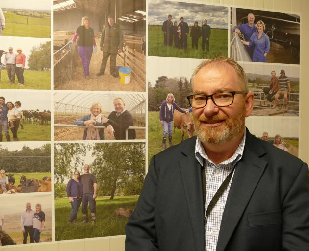 Mataura Valley Milk chief executive Bernard May with photos of farmers/shareholders in the background. Photo: Ken Muir