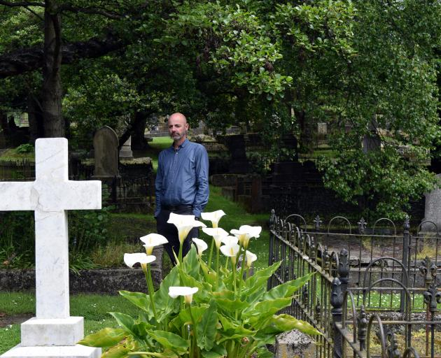 Dunedin Budget Advisory Service executive officer Andrew Henderson inspects graves in the Southern Cemetery in Dunedin on Monday.  Photo: Shawn McAvinue
