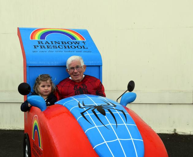 Warren ''Poppa'' Ockwell takes Rainbow Preschool pupil Paige Anderson (4) for a drive in his Spider-Man mobile in South Dunedin. Photo: Shawn McAvinue