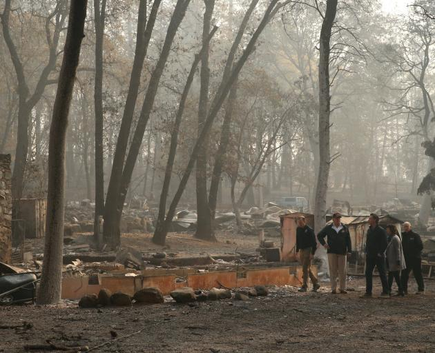 President Donald Trump visits the fire-ravaged town of Paradise with FEMA head Brock Long Governor-elect Gavin Newsom Paradise Mayor Jody Jones and Governor Jerry Brown. Photo: Reuters