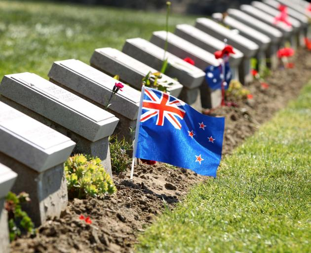 A New Zealand flag flutters among the headstones at Ari Burnu Cemetery on the Gallipoli Peninsula...