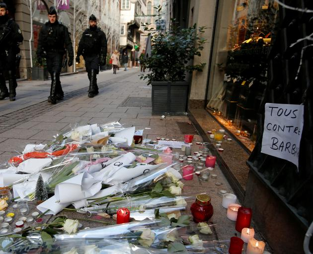Flowers and candles placed in the Rue des Orfevres in tribute to the victims of the shooting....