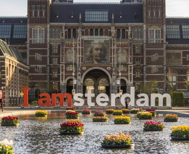 "The giant letters were removed from their place in front of the Rijksmuseum this week after they were deemed to be undermining ""community spirit"" for native Amsterdammers. Photo: Getty Images"