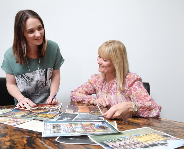 Transport World's communications manager Andie Gentle (left) and executive director Joc O'Donnell work on plans for the NZ Cricket Museum exhibit at Bill Richardson Transport World next year. Photo: Supplied