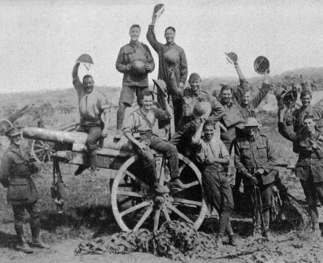 A cheery group of our boys on a captured German 4.2 inch gun taken during the British advance in France. - Otago Witness, 4.12.1918.