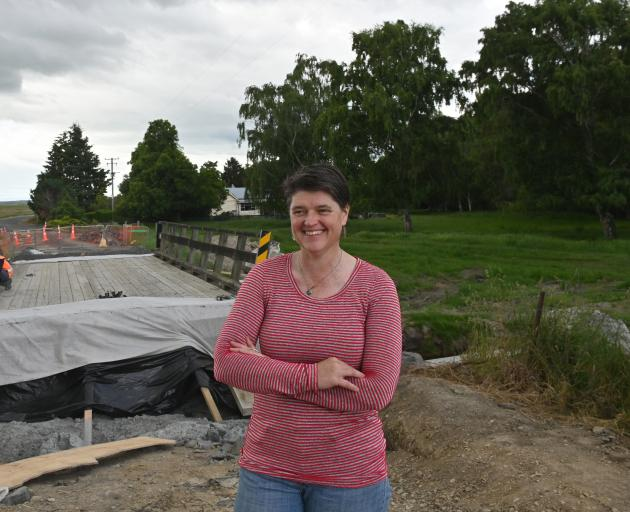 Otago regional councillor Carmen Hope in front of the washed-out Mt Stoker Bridge, which is being repaired by Fulton Hogan civil foreman Merv Morris. Photo: Linda Robertson