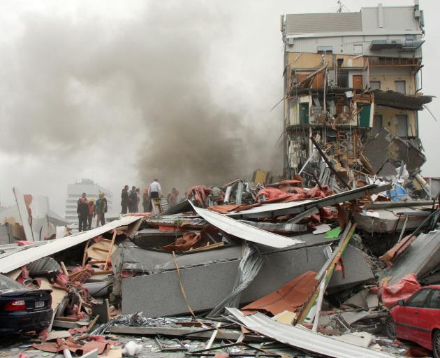 The remains of the collapsed CTV building. Photo : Geoff Sloan