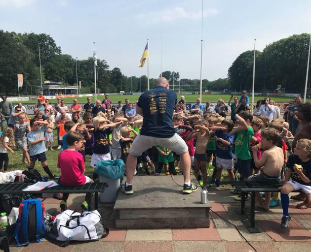 Eben Joubert teaches Dutch children the haka at a rugby club in the Netherlands. Photo: Supplied