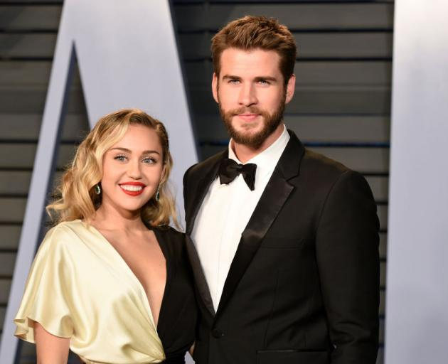 Miley Cyrus and Liam Hemsworth attend the 2018 Vanity Fair Oscar Party in Beverly Hills in March....