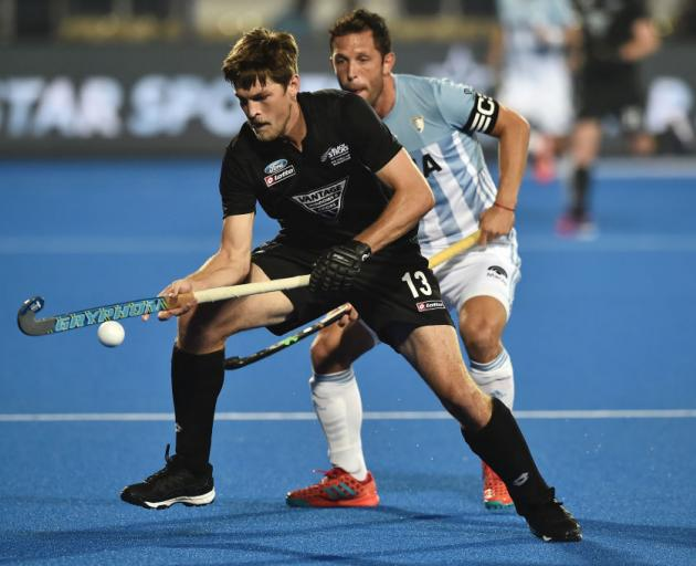 Black Sticks striker Marcus Child controls the ball as Argentina defender Pedro Ibarra looks on during their pool A match at the FIH World Cup match in Bbhubaneswar, India, yesterday. Photo: Getty Images