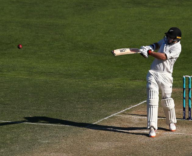 Tom Latham pulls the ball to the boundary during his unbeaten 121 on day two of the first test...