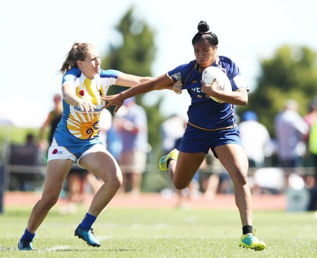 Otago player Alena Saili fends off a Bay of Plenty defender during the national sevens tournament...