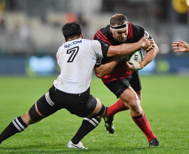 Crusaders prop Wyatt Crockett is tackled by Shunsuke Nunomaki, of the Sunwolves, during the 2017...