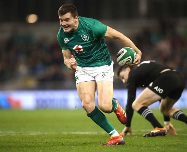 Jacob Stockdale runs in to score his try for Ireland against the All Blacks this year. Photo:...