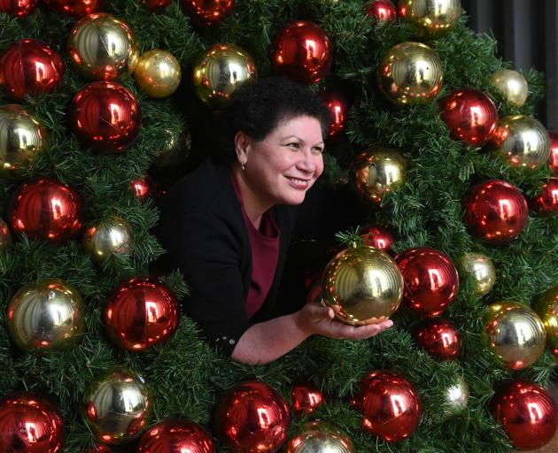 Dunedin City Council community development and events manager Joy Gunn is surrounded by council-owned Christmas wreaths and garlands. Photo: Linda Robertson