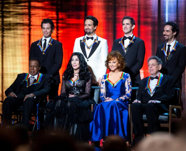 "2018 Kennedy Center honorees, back row from left, the co-creators of ""Hamilton,"" Thomas Kail, Lin-Manuel Miranda, Andy Blankenbuehler and Alex Lacamoire; and front row from left, Wayne Shorter, Cher, Reba McEntire, and Philip Glass. Photo: Reuters"
