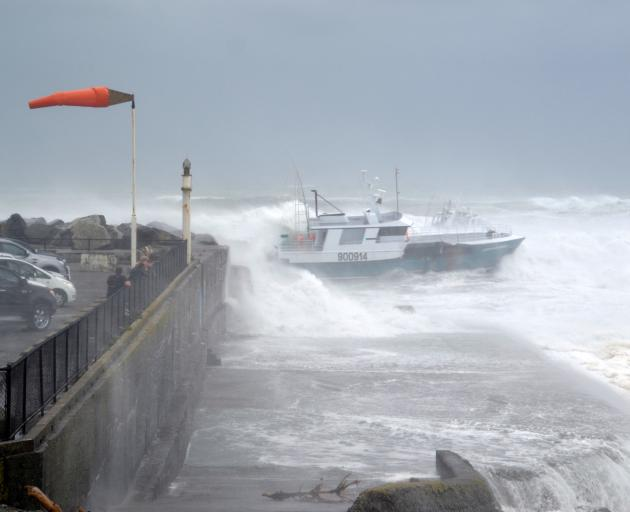 Ocean Odyssey comes close to the rocks as it attempts to enter the Port of Greymouth on February 1. Photo: Greymouth Star