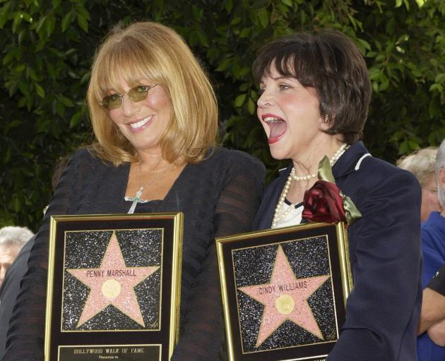 Penny Marshall, and Cindy Williams, who co-starred in the 1970s hit TV series 'Laverne & Shirley', at their Hollwood Walk of Fame ceremony in 2004. Photo: Reuters