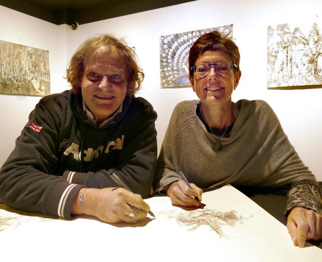 Luigi and Kate Agnelli work on their art in the exhibition space at Lakes District Museum. Photo: Daisy Hudson