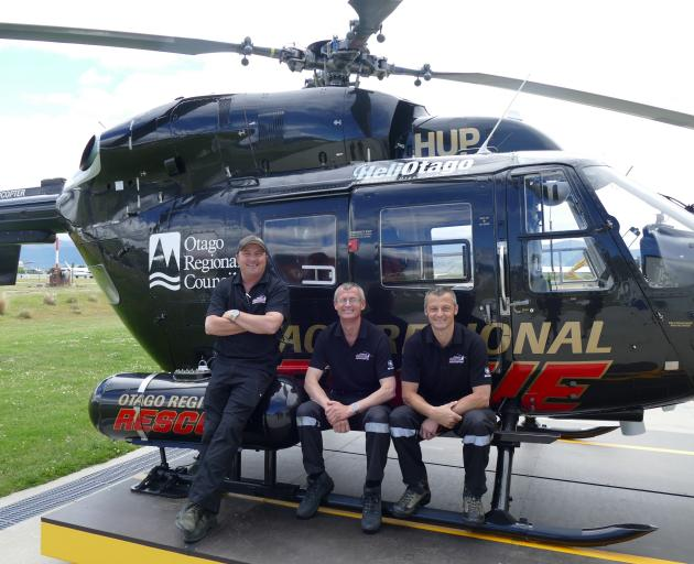 Showing off Queenstown's new dedicated rescue helicopter are Otago Rescue Helicopter's Queenstown team members (from left), pilot Jason Laing and medics Anthony Hoets and Daniel Bentley. Photo: Joshua Walton