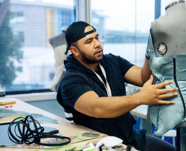 "Queenstown fashion designer Peni Moala works on a garment during a Project Runway NZ challenge. Mr Moala was eliminated from the show on Monday night, and celebrated his experience by launching his first ""BENi'' print collection. Photo: Tom Hollow"