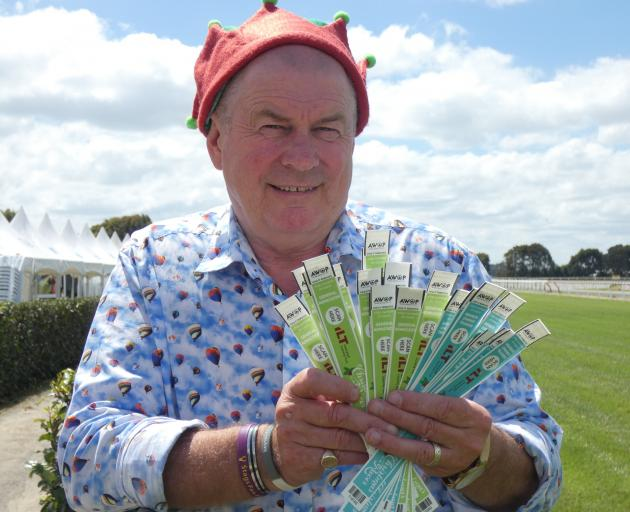 Southland Racing Club president Sean Bellew  shows off some of the electronic wristbands to be...