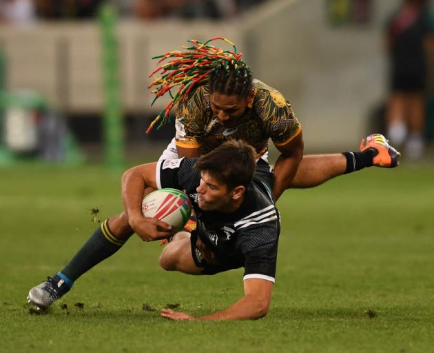 Andrew Knewstubb of New Zealand is tackled by Justin Geduld of the South Africa. Photo: Getty Images
