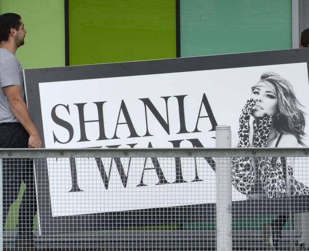 Contractors carry a large sign into Forsyth Barr Stadium for tonight's Shania Twain concert. Photos: Gerard O'Brien
