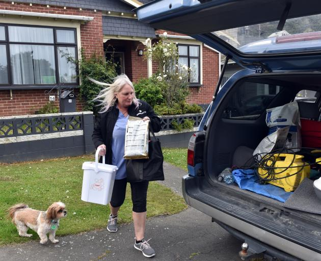 "Motu St property owner Karen McPhee helps her daughter move out ""essentials"" from her property."