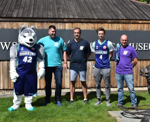 Southern Huskies personnel (from left) mascot Mawson, chief executive Justin Hickey, inaugural...