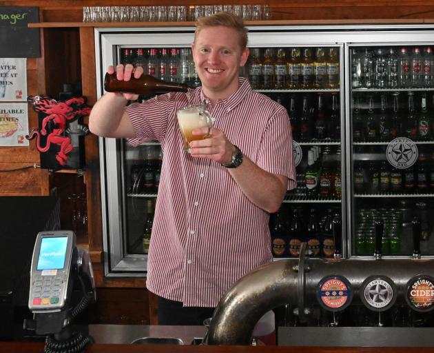 Behind the bar at Starters Bar, recently bought by the Otago University Students' Association (OUSA), is its events manager, Jason Schroeder. Photos: Linda Robertson