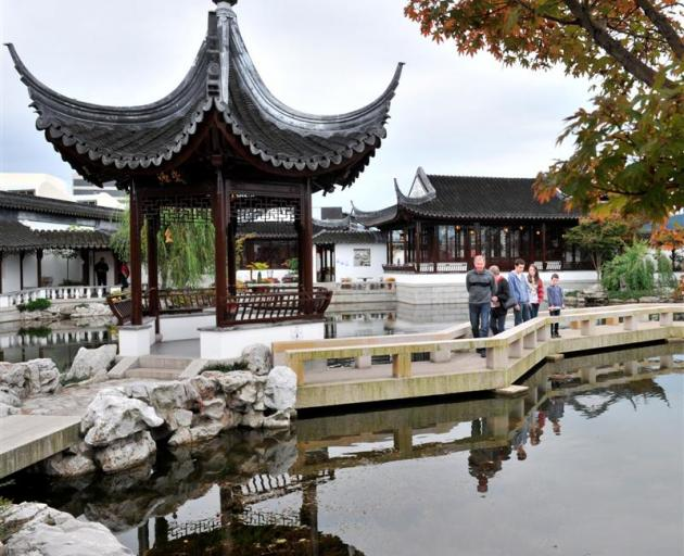 Visitors at the Chinese Garden yesterday.