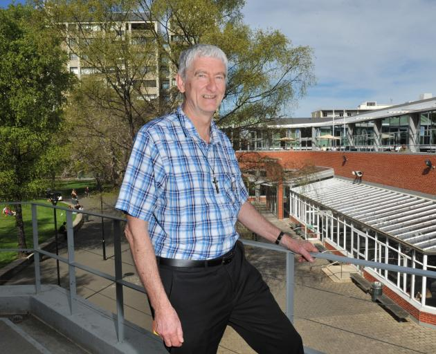 University of Otago chaplain the Rev Greg Hughson looks out over the campus. Photo: ODT